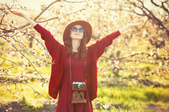 Women with camera in blossom apple tree garden Royalty Free Stock Images