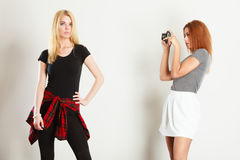Women with camera Royalty Free Stock Photography