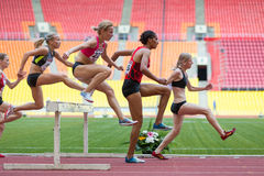 Women can easily overcome obstacles. MOSCOW - JUN 11: Women can easily overcome obstacles on International athletic competition Moscow Challenge on June 11, 2012 Stock Images
