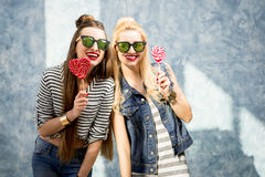 Women with candies indoors Stock Images