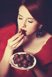 Women with candy. Royalty Free Stock Image