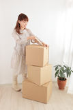 Women and cardboard Royalty Free Stock Photo