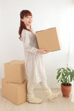 Women and cardboard Royalty Free Stock Photography