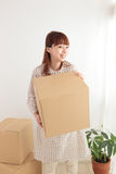 Women and cardboard Royalty Free Stock Images