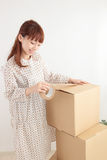 Women and cardboard Stock Photography