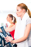 Women at cardio training in gym Stock Photos