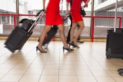 Women carries their luggage at the airport Royalty Free Stock Photography
