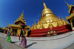 Women carring fruits on her head at Shwemawdaw Paya Pagoda. Royalty Free Stock Photo