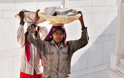 Women carry basket of stones on their head at Golden Temple. Amritsar. India Stock Images