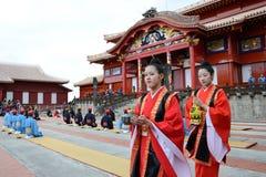 Women carry the bottle of sake Stock Image
