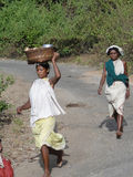 Women carry goods on their heads Stock Image