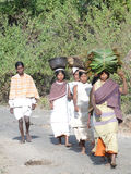 Women carry goods on their heads Stock Photos