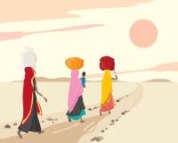 Women carrying bundles Stock Image