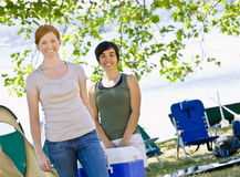 Women carrying cooler Stock Images
