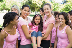Women carrying girl during breast cancer awareness Stock Photography