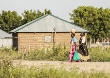 Women carrying goods, South Sudan Royalty Free Stock Images