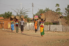 Women carrying loads, South Sudan Stock Images