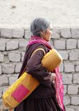A women carrying mat while going for Dalai Lama speech. CHOKLAMSAR, LADAKH-AUGUST 21: Old aged people moving to Shewatsel ground at Choklamsar near Leh, Ladakh Stock Photos