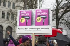 Women carrying plaques on march for equality stock photography