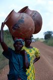 Women carrying pots on their heads in Burundi. Royalty Free Stock Photos