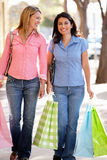 Women carrying shopping Stock Photo