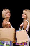 Women carrying shopping bags Stock Photos