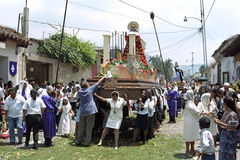 Women carrying shrine during Holy Week procession royalty free stock photo