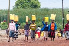 Free Women Carrying Water Stock Photo - 70696900