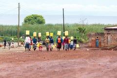 Women carrying water Stock Photo