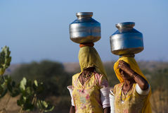 Women carrying water in Rajasthan Royalty Free Stock Photography