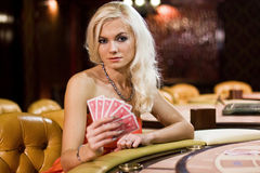 Women in casino. Young women in casino with playing cards Royalty Free Stock Images