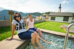 Women in Castelrotto kneipp pool Royalty Free Stock Photography