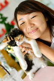 Women with cat. Thai girl show the baby cat Royalty Free Stock Photography