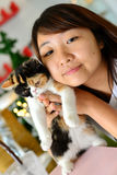 Women with cat. Thai girl show the baby cat Royalty Free Stock Photos