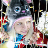Women with cat winter hat posing Outdoor Christmas decorations Royalty Free Stock Photo
