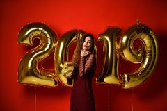 Women celebrating New Year party happy laughing with Christmas 2019 gold balloons stock images