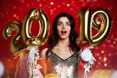 Women celebrating New Year party happy laughing in silver casual dress with christmas lights royalty free stock photography