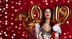 Women celebrating New Year party happy laughing in silver casual dress with christmas lights stock image