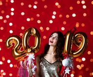 Women celebrating New Year party happy laughing in silver casual dress with christmas lights royalty free stock photo