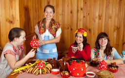 Women celebrating Shrovetide and eats pancake stock photo