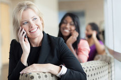 Women on cell phones Royalty Free Stock Photo