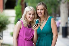 Women With Cellphone Smiling Royalty Free Stock Photos