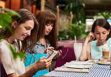 Women chatting in cafe Stock Image
