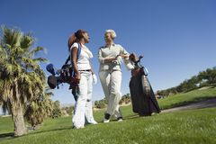 Women Chatting At Golf Course Stock Photo