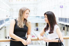 Women chatting indoors Royalty Free Stock Images