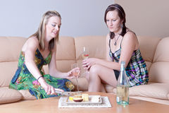 Women chatting over cheese and wine royalty free stock photos