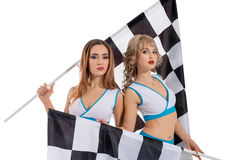 Women with checkered race flags isolated on white Stock Photos