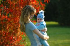 Women and child. On autumn background Royalty Free Stock Photo