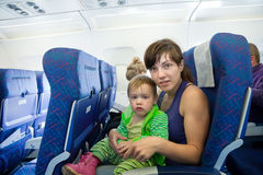 Women with child in  airplane cabin Stock Image