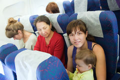 Women with child in cabin. Women with child in the airplane cabin Stock Photography